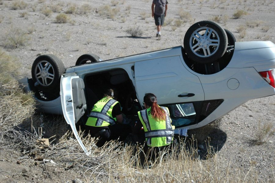 Woman Suffers Medical Episode Before Rolling Vehicle